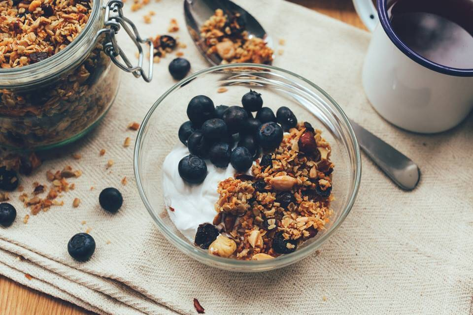 whole foods breakfast with oatmeal, yogurt and blueberries