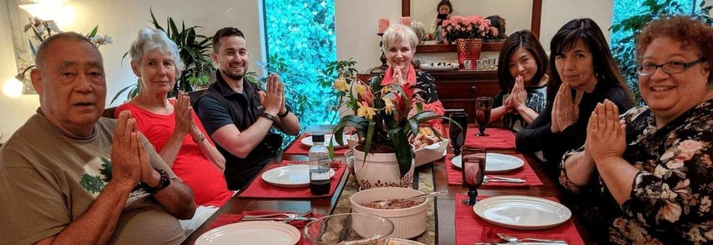jared levenson leading eating disorder support group with people eating food in prayer pose
